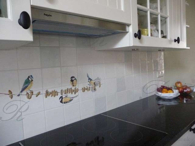 Robins, swallows or sparrows flying in kitchen