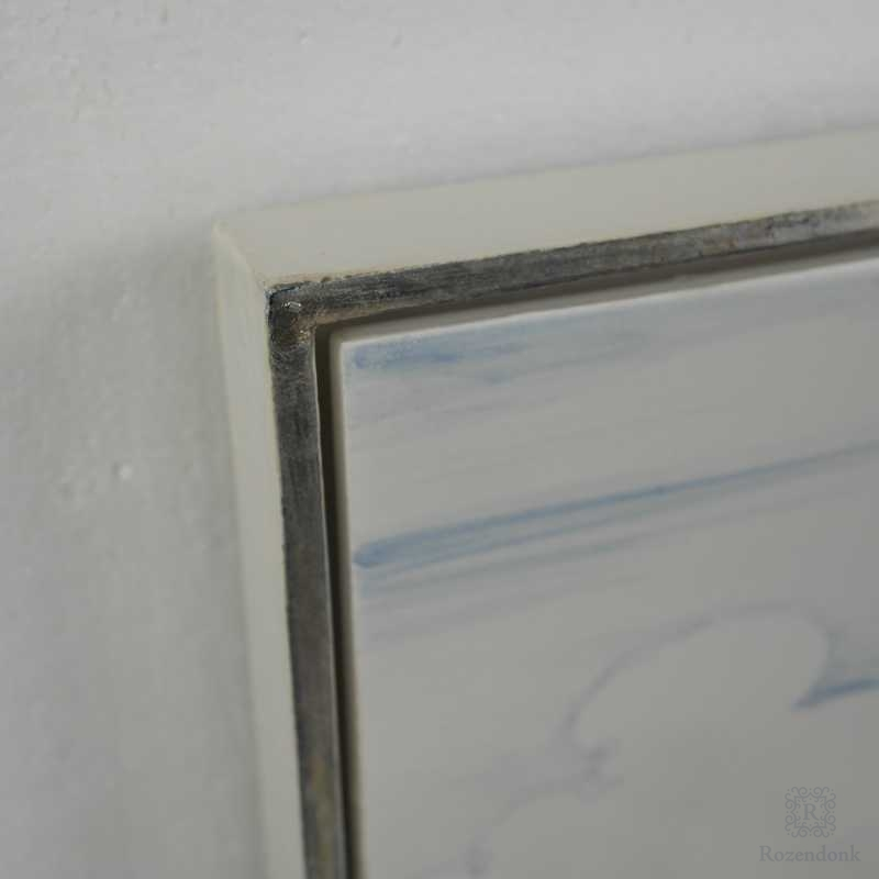 Motif mounted in a frame
