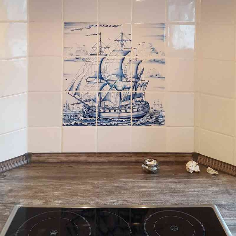 a ship painted on tiles