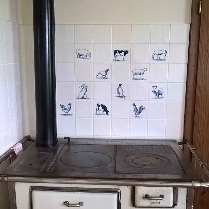 Animals behind an antique stove