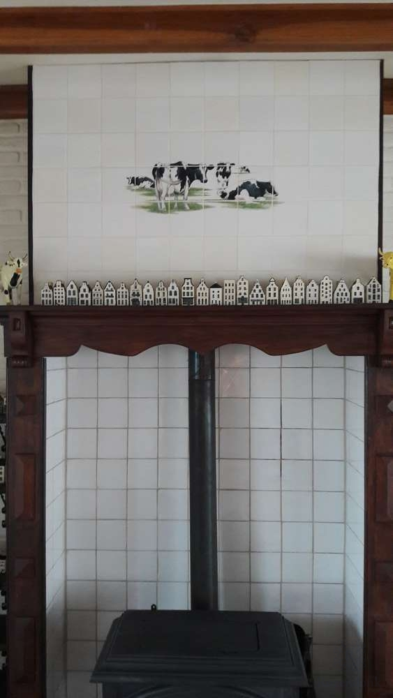 4 curious cows painted on tiles