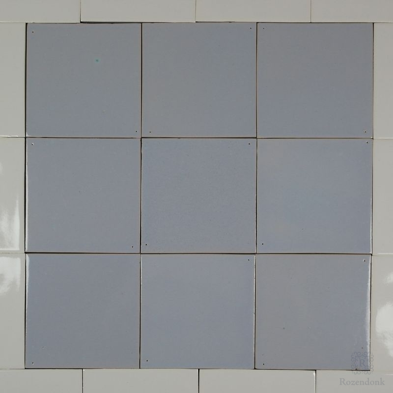 Old blue tiles with pinholes