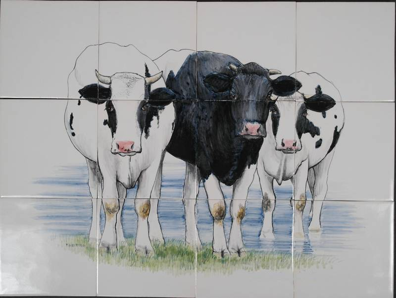 3 cows in the water